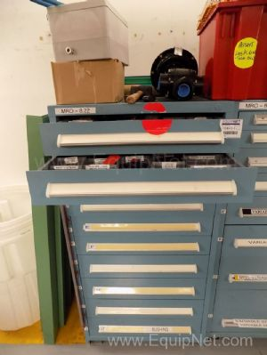 Parts Cabinet with Assorted Sized Sprockets and Bushings