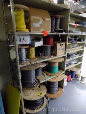 2 Racks Filled with Assorted Spools of Electrical Wiring