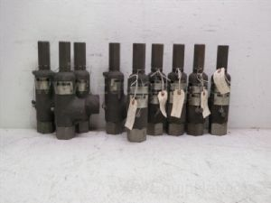 Lot of 9 Dresser various models 1-inch outlet by one and one-half inch outlet pressure relief valves