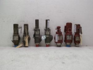 Lot of 7 three-quarter inch to 1-inch in by one-inch to one and one-half inch out pressure valve