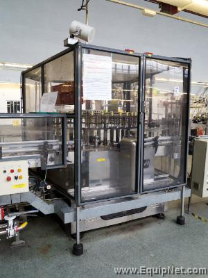 Krones Starmatic labelling machine with 2 label stations and Taxomat tax strip applicator.
