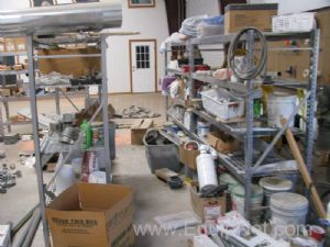 Lot of Assorted Desks and Racks with MRO Equipment and Electric Wire Rolls