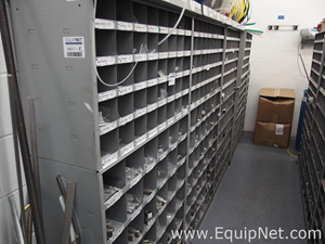 Eight Shelving Units of Assorted Fittings and Hoses