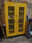 Yellow Storage Cabinet with Grinder and Welding Supplies